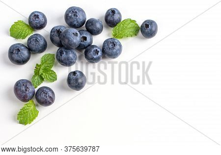 Blueberry Fruit Top View Isolated On A White Background, Flat Lay Overhead Layout With Mint Leaf, He