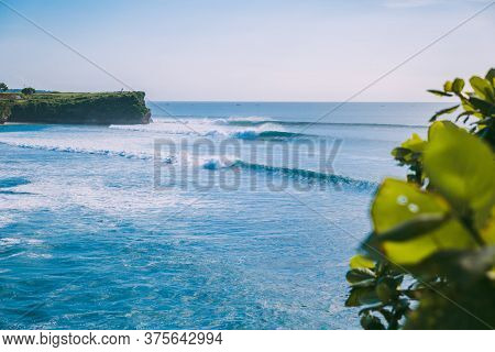 Surfing Waves For Surfing In Bali. Beach And Perfect Waves In Indonesia