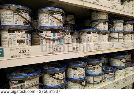 Moscow, Russia - August 17, 2019: Plastic Jars With Grout For Ceramic Tiles On The Rack In A Buildin