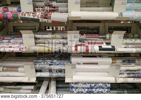 Moscow, Russia - August 17, 2019: Different Wallpapers On The Rack In A Building Materials Hypermark