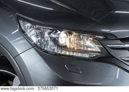 Novosibirsk/ Russia - June 23 2020: Honda Cr-v, Gray Car Headlights. Exterior Detail. Close Up Detai