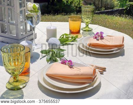Elegant Table Setting. Plates With Napkins, Knife And Fork, Wine Glasses, White Tablecloth. Celebrat
