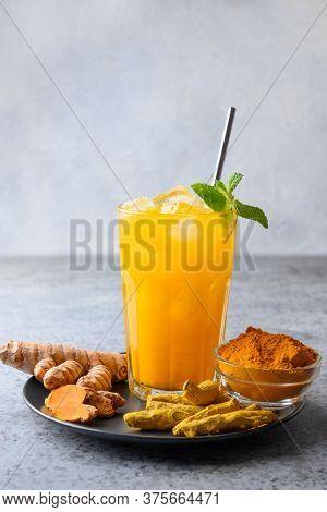 Turmeric Beverage Jamu With Ingredients. Ayurvedic Drink. Vertical. Close Up.