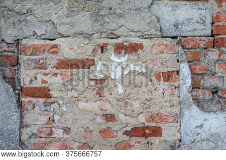 Background From The Texture Of An Old Brick Wall With Ruined Concrete