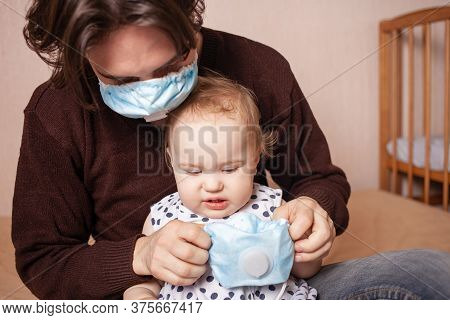 The Child Does Not Want To Wear A Medical Mask. One Year Old Girl