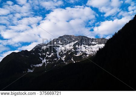 Mountain Peak With Clouds, Landscape In The European Alps