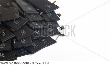Close Up Of Old Used Li-ion Polymer Batteries Of Mobile Phones Preparation For Recycling. Copy Space