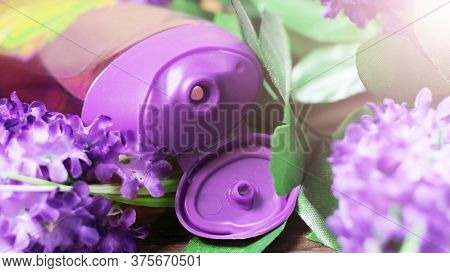 Shower Gel And Purple Flowers So Close