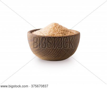 Heap Of Cane Sugar Isolated On White Background. Heap Of Brown Sugar On White Background. Wooden Bow