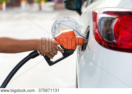 Man Refill And Filling Oil Gas Fuel At Station.gas Station - Refueling.to Fill The Machine With Fuel