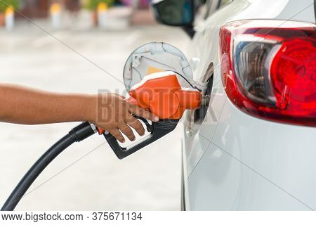 Refill And Filling Oil Gas Fuel At Station.gas Station Refueling. To Fill The Machine With Fuel. Car