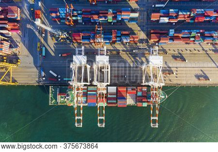 Top View Of Industrial Port With Containers In Import-export Business Logistic Transportation Of Int