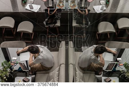 Bangkok, Thailand, Jul 04, 2020 : Top View Of A Young Man Works Or Study Online On The Black Table I