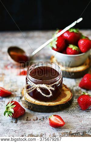 Selective Focus. Macro. Fresh Strawberries In A Bowl And Strawberry Jam In A Jar. Strawberry Jam Con