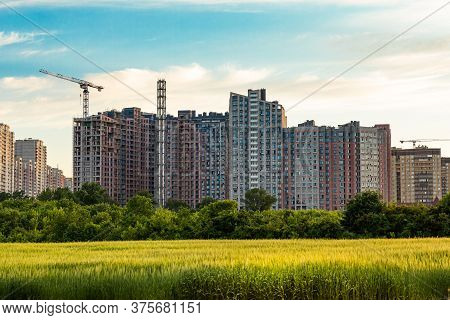Construction Of An Apartment Building. A New Large Neighborhood On The Outskirts Of The City.