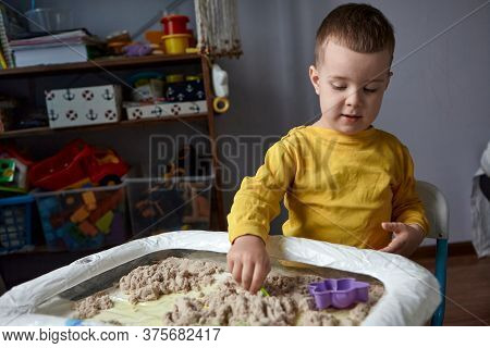 The Boy Is Playing In His Room. Educational Game. A Child Plays Kinetic Sand In Quarantine. Developm