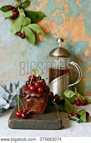 Tasty Chocolate Cake (brownie) With Cherry On A Wooden Board.