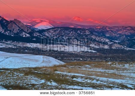 Alpinglow Snow Mountains At Sunrise Over Boulder