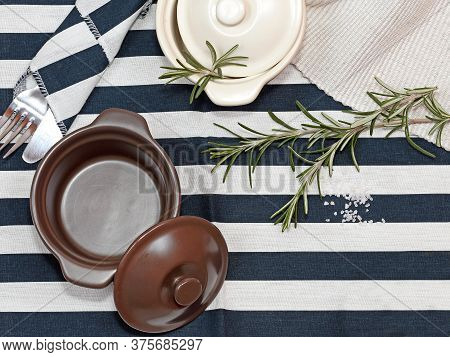 Sprig Of Rosemary Herb Plant And Ceramic Pots