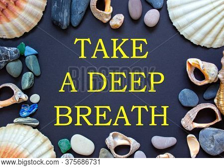 Text 'take A Deep Breath' On A Beautiful Black Background. Sea Stones And Seashells. Concept.