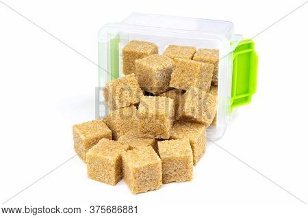 Cane Brown Sugar Isolated On A White Background. Cane Sugar In A Container.healthy Food. Plastic Con