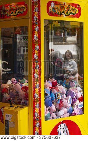 Claw Crane Maschine. Classic Claw Grabber Game Machine Filled With Toys. Copenhagen, Denmark - July