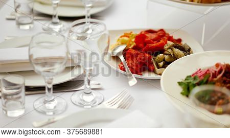 Catering. Served Table With An Emphasis On Pickled Vegetables Cucumbers And Peppers