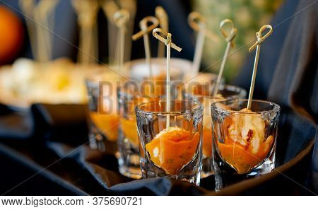 Orange Treats In A Glass On A Table With A Cloth