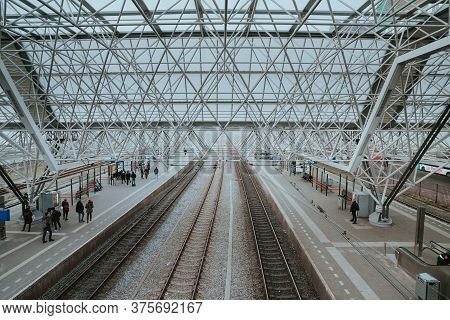 Zaandam, Netherlands - March 6, 2020: People Are Waiting For The Train At Zaandam Railway Station