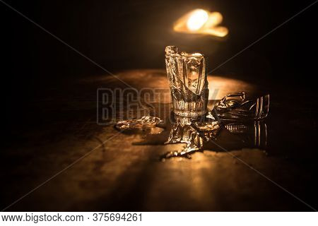Broken Glasses On Wooden Table At Dark Toned Background With Fog. Selective Focus
