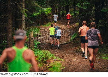 Trail Running Race, Athletes Run In The Forest. Up Hill Vertical Race