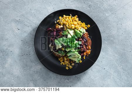 Healthy Plant-based Food Recipes Concept, Vegan Mexican-inspired Beans Corn And Avocado Toast