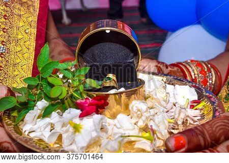 Close Up Image Of Gold Ring Of Bride & Bridegroom On Indian Hindu Marriage Ceremony.