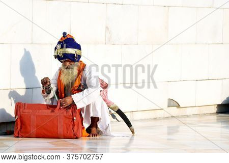 Amritsar, India - December 03, 2019: Unidentified Sikh Man Visiting The Golden Temple In Amritsar, P