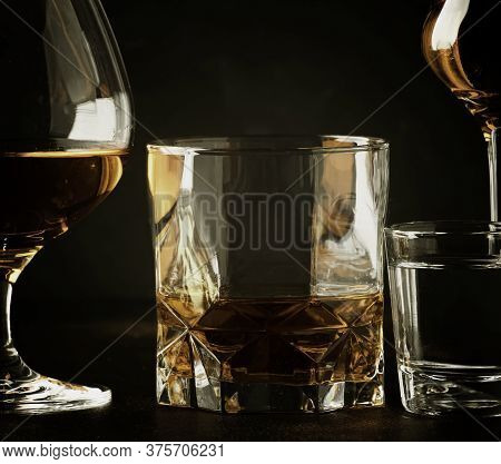 Set Of Strong Alcoholic Drinks In Glasses And Shot Glass In Assortent: Vodka, Rum, Cognac, Tequila,