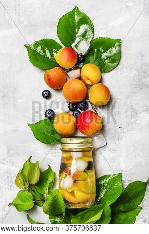 Iced Fruit Tea With Apricot, Blueberry And Ice, Food Background, Top View
