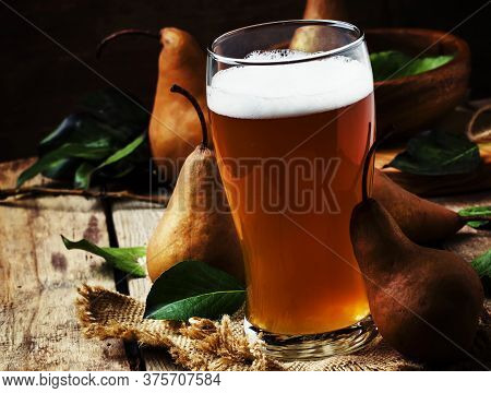 Pear Cider In A Large Beer Glass, Old Wooden Background, Selective Focus