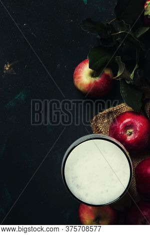 Apple Cider In Beer Glass With Fresh Apples, Black Background, Top View