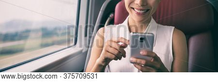 Phone texting businesswoman using mobile cellphone in train transport commuting people lifestyle banner panorama.