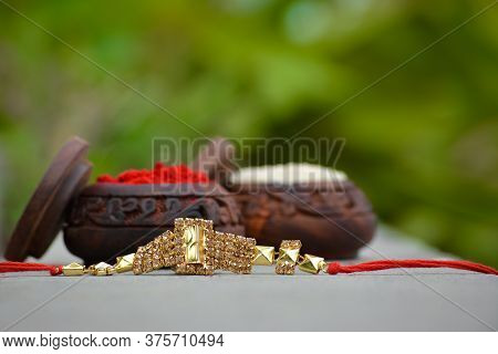Raksha Bandhan Rakhi With Rice Grains And Kumkum. A Traditional Indian Wrist Band Which Is A Symbol