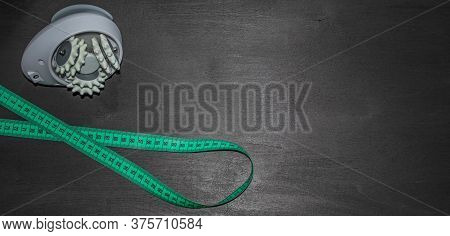 Anti-cellulite Massager And Measuring Tape Isolated On Dark