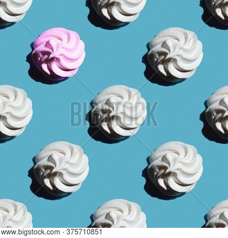Seamless Pattern Is A White Marshmallow Or Meringue And One Pink Marshmallow Isolated On A Classic B