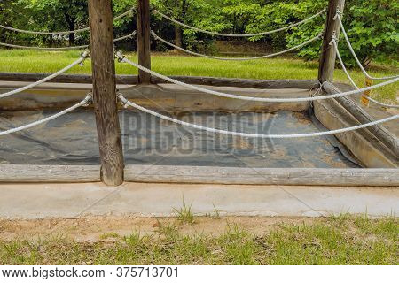 Daejeon, South Korea; July 7, 2020: Preserved Underground Storage Pit At Archeological Site In Yuseo