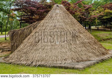 Closeup Of Straw Thatched Hut Beside Hiking Path At Prehistoric Archeological Site In Daejeon, Korea