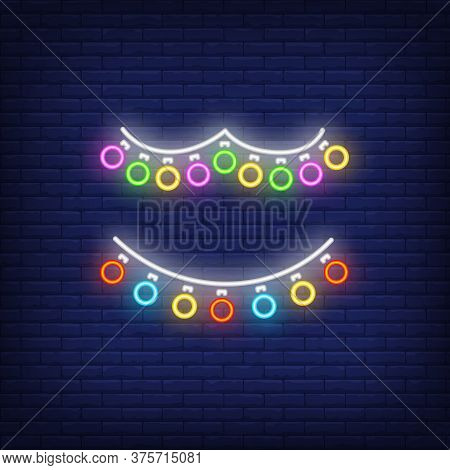 Multicolored Retro Garland Neon Sign. Glowing Multicolored Lamps On Dark Blue Brick Background. Can