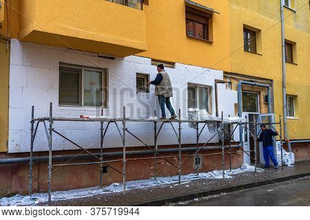 Workers Isolating Apartment With Polystyrene, Thermal Isolation Of Facade Of House In Lugoj, Romania