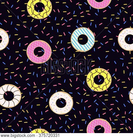 Seamless Pattern Of Doughnuts With Colored Icing. Trendy Beautiful Donuts Black Background