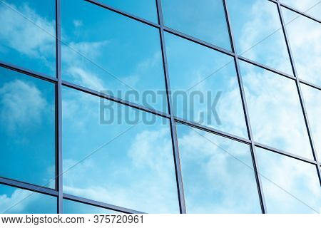 Reflection Of The Sky In The Windows
