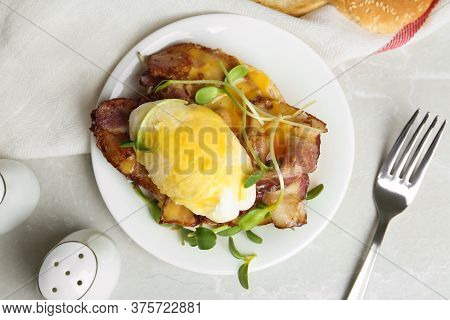Delicious Egg Benedict Served On Light Grey Marble Table, Flat Lay