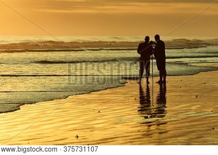 Dunedin, New Zealand - Jan 2020. Unidentified Photographers Taking Photographs Of A Sunset At The Se